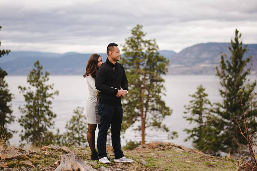 Man and woman standing on a cliff looking out