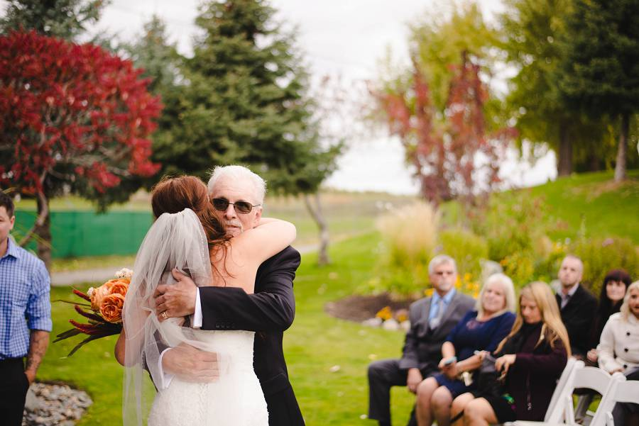 bride hugging her father at Sunset Ranch
