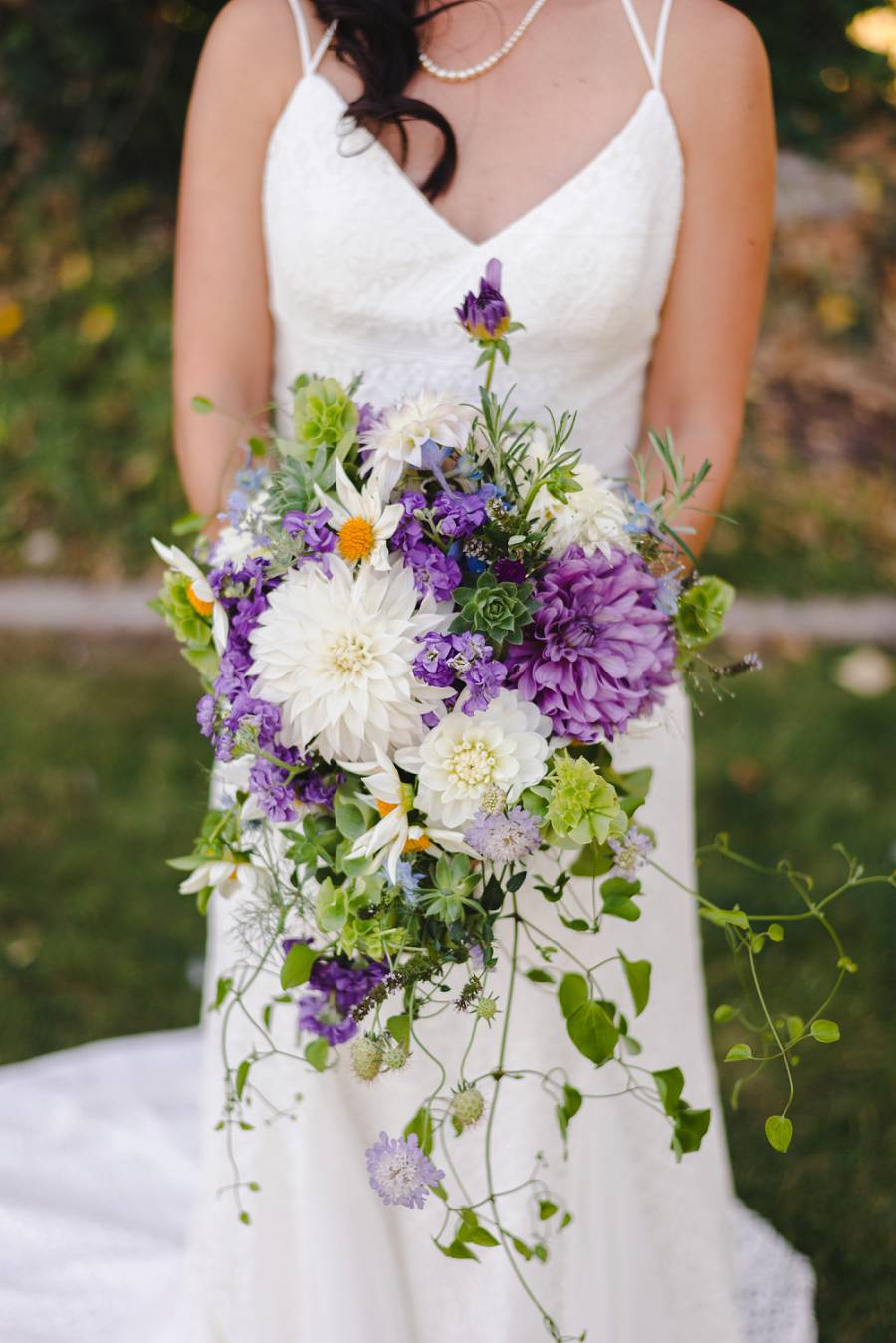 portrait of bride holding a bouquet of flowers
