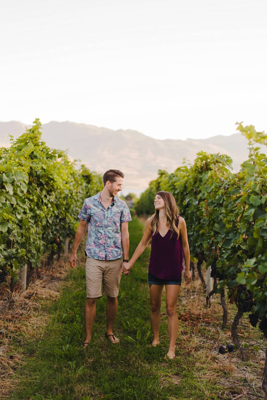 Couple walking through West Kelowna vineyard