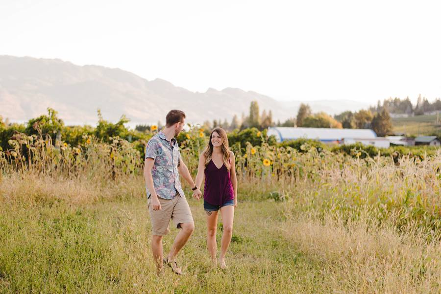 Couple walking through garden in West Kelowna