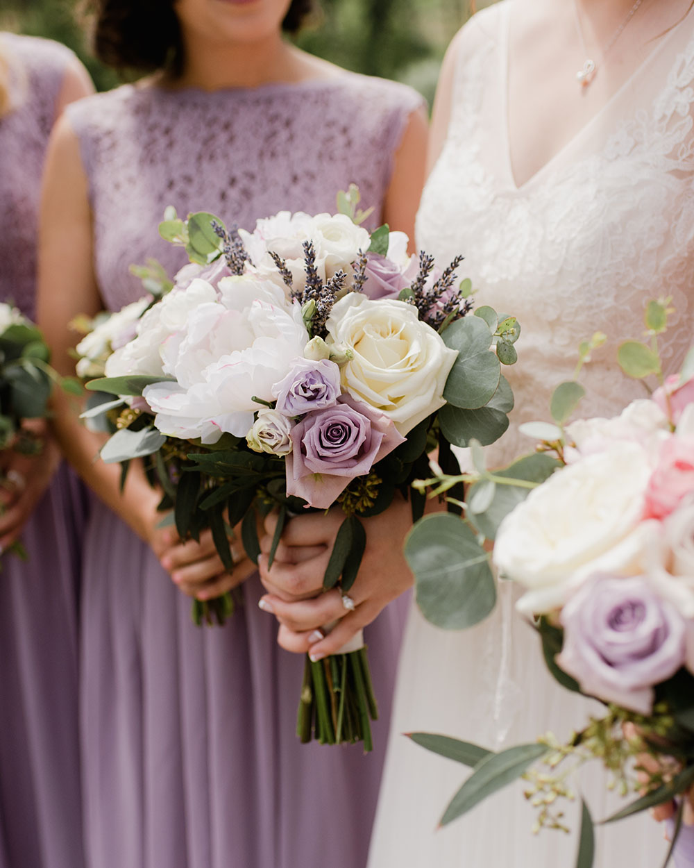 Bride holding a bouquet of flowers .