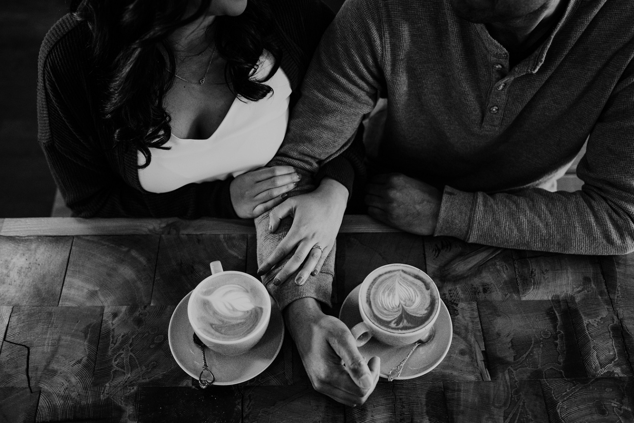 Man and woman holding hands at a coffee shop, Bean Scene Kelowna