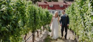 bride and groom walking through a vineyard at See Ya Later Ranch